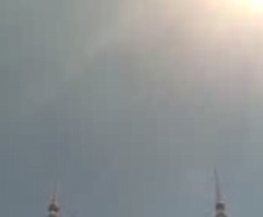 Mobile video still, showing the spires of the Petronas Twin towers during call to mid-morning Zohor prayers.