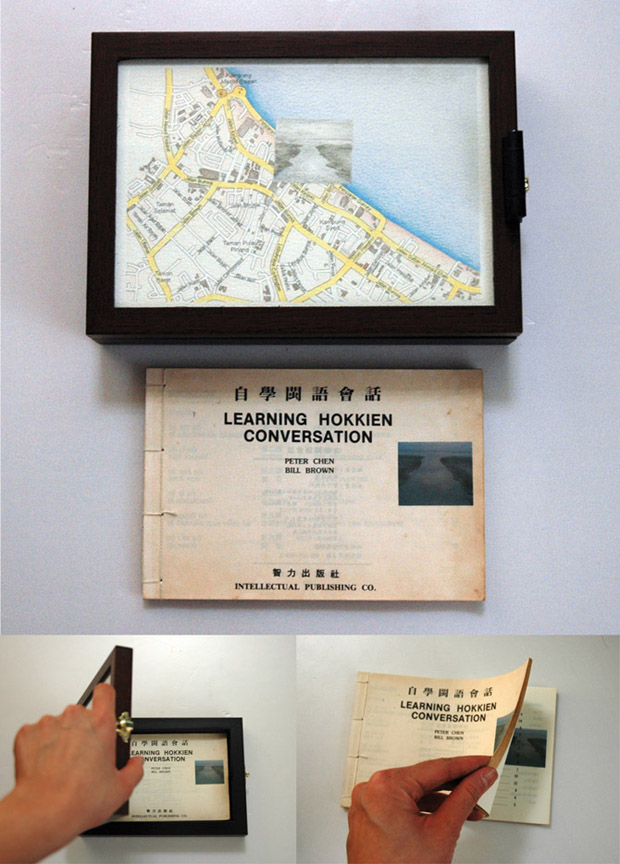 Pocket Seas: Gurney Drive, 12:08pm – Hokkien, 22.5cm x 16.0cm, Hand drawn map (graphite, color pencil and charcoal on paper), wooden box, hand-bound old dictionary printed with images transferred from mobile phone video.
