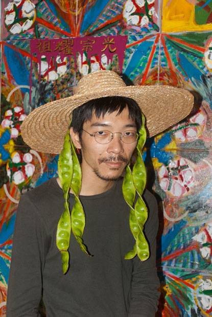 Photo of Fei by Minstrel Kuik. One of his paintings is in the background.